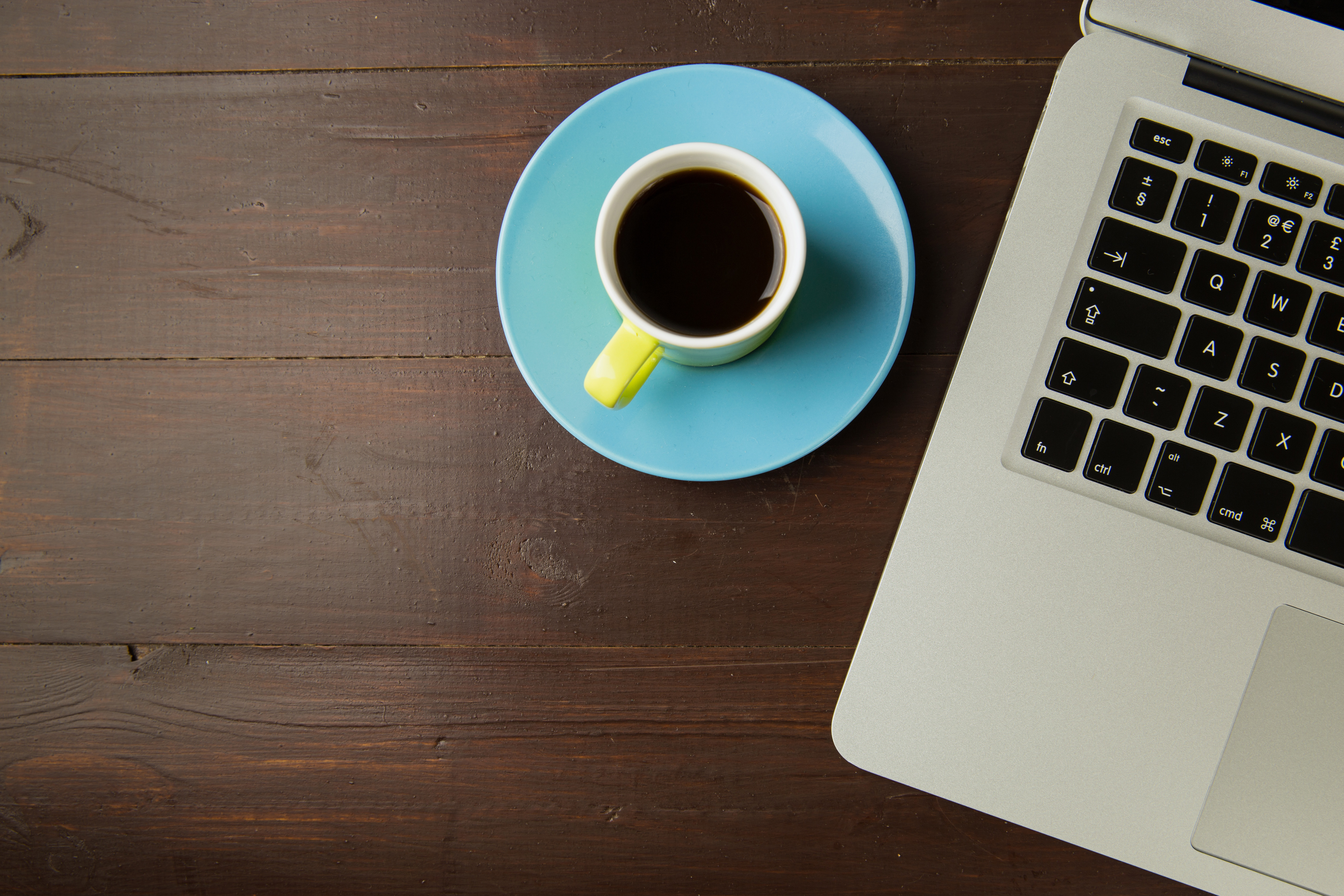 Canva Coffee Cup and Laptop Computer on Office Table